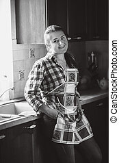 portrait of smiling housewife in apron