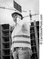 Black and white portrait of young construction engineer...