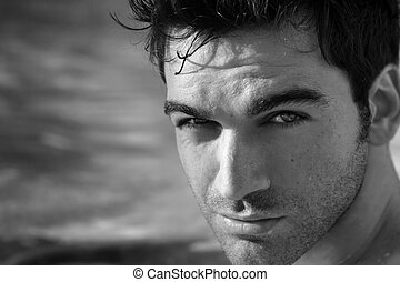 Black and white portrait of young good looking man