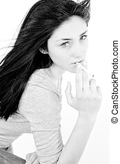 Black and white portrait of young sad woman smoking