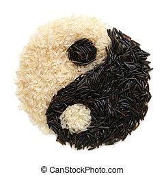 Black and white rice forming a yin yang symbol