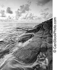 black and white Sea and rock at morning