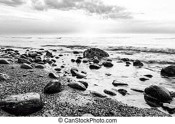 Black and white sea. Waves hitting in rocks