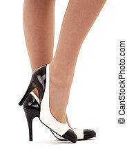 black and white shoes - closeup picture of female legs in...