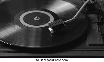 Black and white shot of a record player playing vinyl. Retro Vinyl Turntable Stylus
