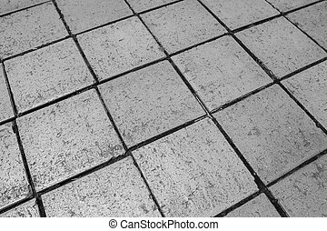 Black and white tiles give a harmonic pattern at the ground