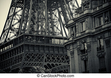 Close up of a black and white tour eiffel and a palace in Paris
