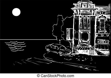facade of an old house and a car from the sea at night