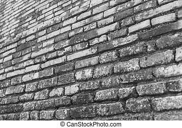 Black and white view of old brick wall with selective focus