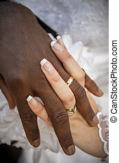 Black and white wedding - Close up of palms with wedding ...