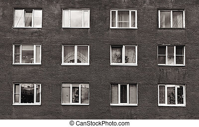 black and white windows of the old multistory building