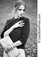 black and white woman fashion model outdoor portrait