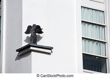 Black angel on white conceptual contrast design