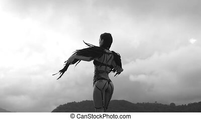 Black angel woman on the roof - Back view of beautiful...
