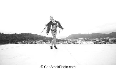 Black angel woman on the roof - Black and white video of...