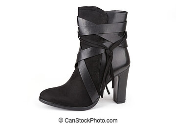 Black ankle boot with a tassel isolated on white