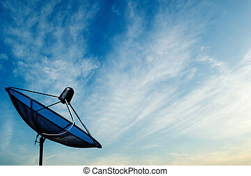 black antenna communication satellite dish on blue sky background