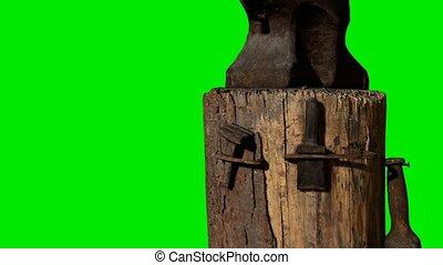 Black anvil on green chromakey background