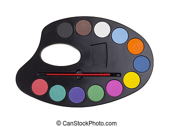 black art palette with paint and brushes isolated on white