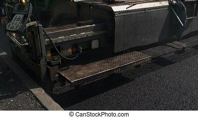 Black asphalt surface.