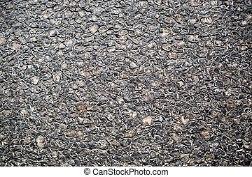Black asphalt texture, useful as background for design works