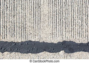 black asphalt with cement background