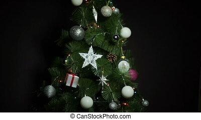 Black background with Christmas Balls and lights on Christmas Tree