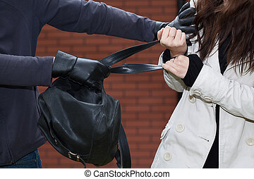Black backpack stealing - A thief stealing a black leather...