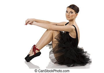 black ballerina sitting