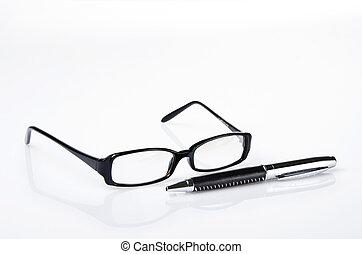 Black ballpoint pen and glasses