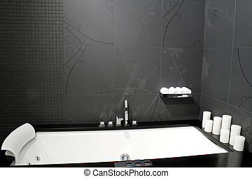 Contemporary black bathroom with geometric bathtub and candles