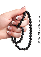 black beads in hand
