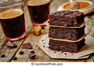 black bean brownies on a dark wood background. the toning....