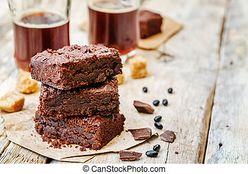 black bean brownies on a white wood background. the toning....