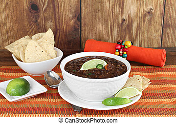 Black bean mexican soup with chips and lime. - Healthy black...