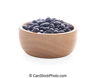 black beans in wood bowl isolated on white background