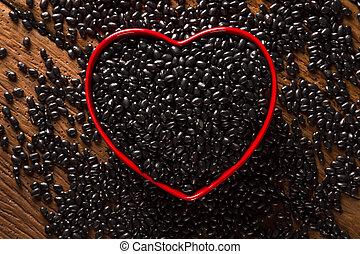 black beans on wood background