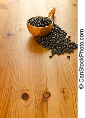 Black beans on wooden background