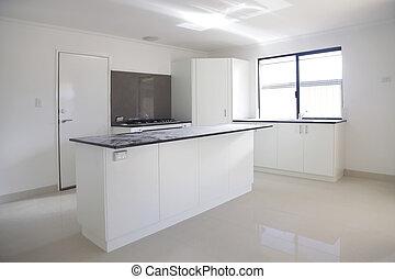 black benchtop kitchen being built onto beige floor