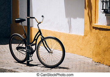 Black bicycle parking on street In European City