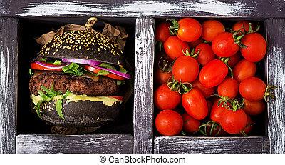 Black big sandwich - black hamburger with juicy beef burger,...