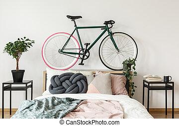 Black bike in bedroom
