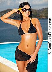 Black Bikini Girl - Beautiful young Sexy woman standing in...