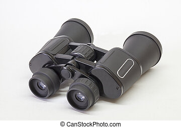 Black binoculars insulated on light background
