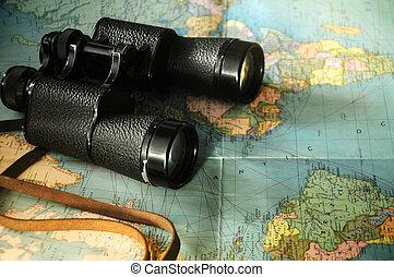 Black binoculars on the old map