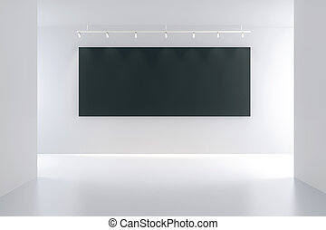 Black blank picture frame in a white room, mock up