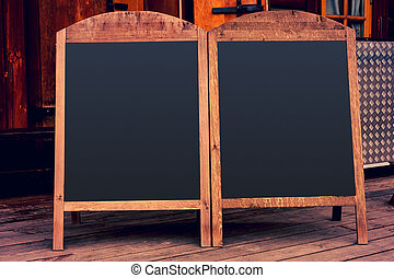 Black blank wooden menu outside. Empty space. Restaurant menu.