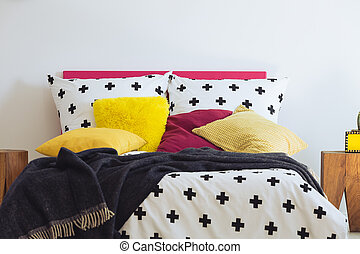 Black blanket on king-size bed