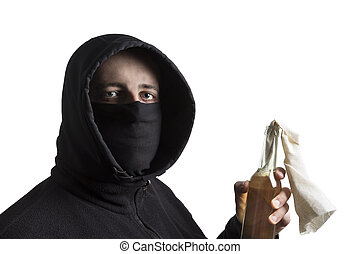 Hooded man in black dress holding a molotov cocktail isolated on white background