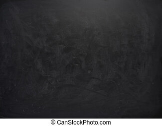 Black board with the traces of chalk over its surface as a...